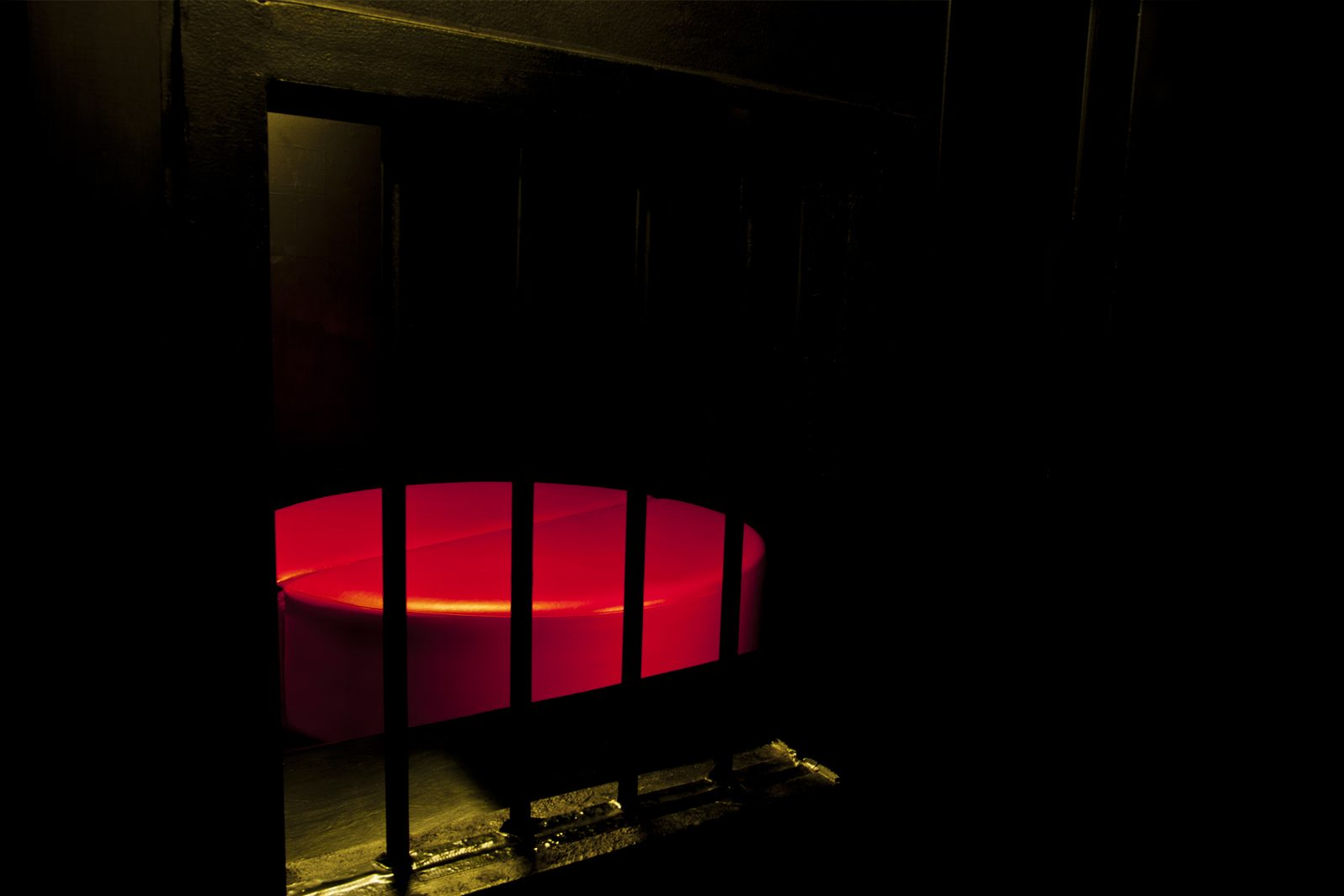 Sexy circular bed in the dark room.
